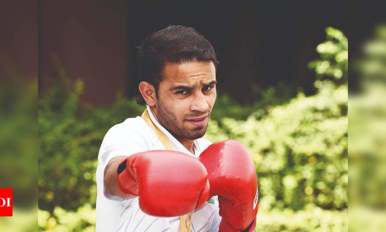 Amit Panghal clinches gold, injured Satish bags silver at Cologne World Cup | Boxing News - Times of India