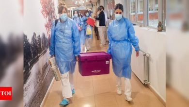 EU's marathon Covid vaccination drive off to uneven start - Times of India