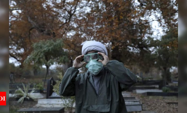 Far from the capital, Iran struggles to bury coronavirus victims - Times of India