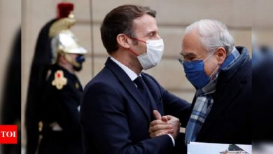 From bows to handshakes, how Macron let social distancing slip - Times of India