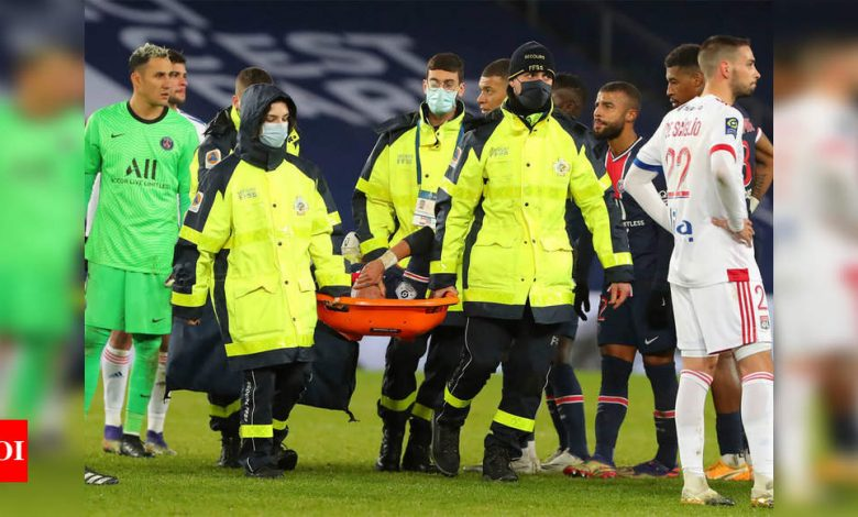 Lyon defeat PSG as Neymar stretchered off with ankle injury | Football News - Times of India