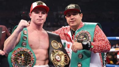 Mexico's Canelo Alvarez overpowers British boxer Callum Smith to claim two world super middleweight titles