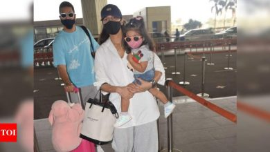 PHOTOS: Neha Dhupia snapped at the Mumbai airport with hubby Angad Bedi and their daughter Mehr - Times of India