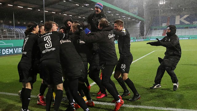 German Cup: Bayern Munich knocked out of tournament for first time in 20 years by second-division team Holstein Kiel