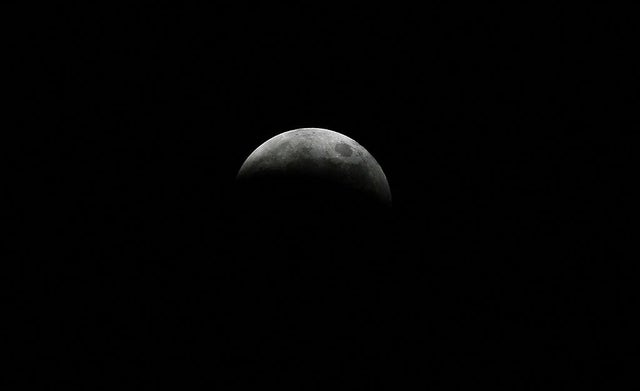 The moon, pictured here during a lunar eclipse, takes on eight different appearances during a lunar cycle, including that of a new moon. (Pic: Getty)