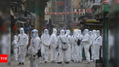 Thousands of Hong Kongers locked down to contain coronavirus - Times of India