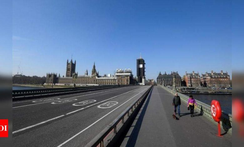 With the virus surging, Britain returns to a lockdown - Times of India