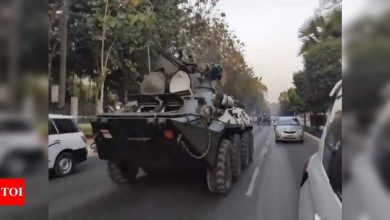 Armoured vehicles deployed to major Myanmar cities after mass protests - Times of India