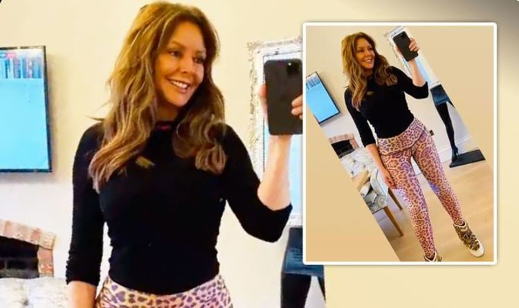 Carol Vorderman poses in skintight leopard print in defiant pic