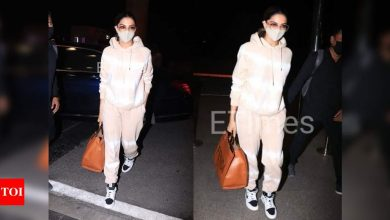 Photos: Deepika Padukone keeps it cool and comfy in a hoodie teamed with track pants for her airport look! - Times of India