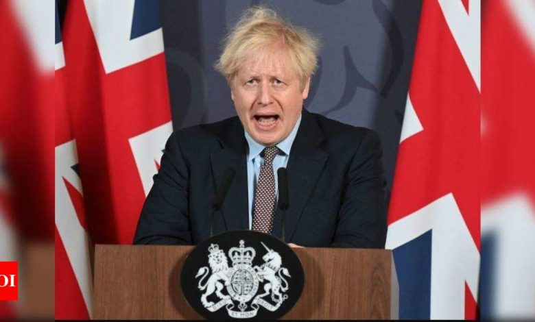 UK's PM cautious on lockdown easing as new hotel regime starts - Times of India