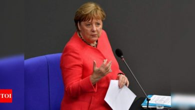 Bowing to pressure, Merkel eases virus curbs - Times of India
