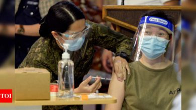 'Light' after darkness as Philippines Covid-19 vaccinations begin - Times of India