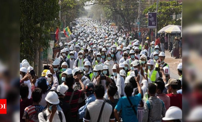 Protesters defy Myanmar security forces as UN action urged - Times of India