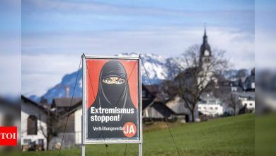 Switzerland votes to ban 'burqa' in public - Times of India