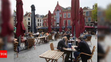 Guests flock to Dutch cafe terraces as lockdown eases - Times of India