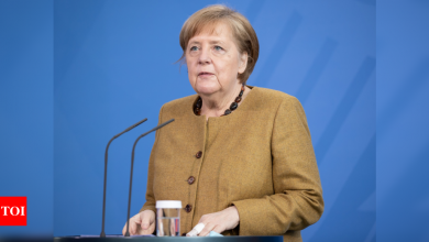 Angela Merkel under fire over German Covid-19 lockdown law - Times of India