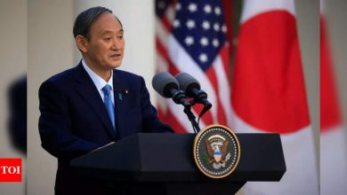 Japanese PM Suga asks Pfizer for additional vaccine supply - Times of India