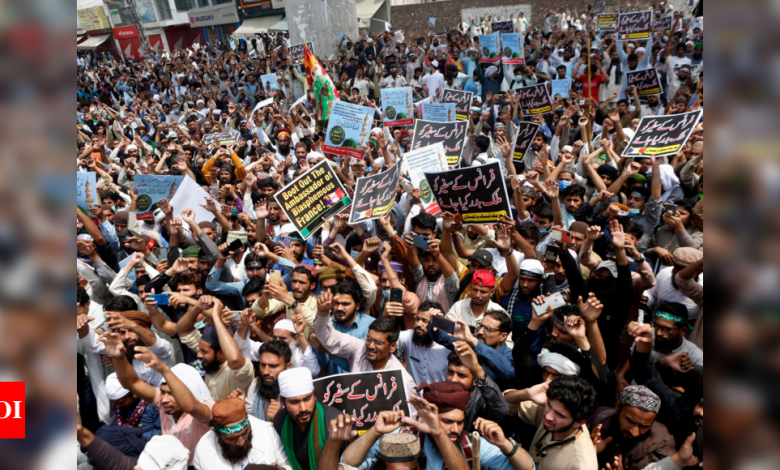 Pakistan Protest: Islamists call halt to Pakistan protest after government allows vote on French envoy | World News - Times of India