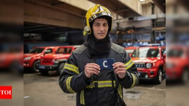 Serbia's firefighters auction Ronaldo's armband to help sick boy | Football News - Times of India