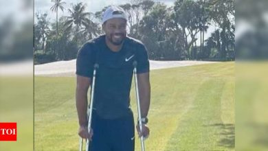 Smiling Tiger Woods on crutches with cast in new photo posting   Off the field News - Times of India