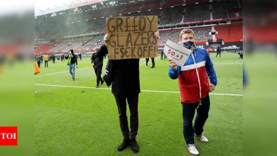 Manchester United fans storm Old Trafford pitch in anti-Glazer protest | Football News - Times of India