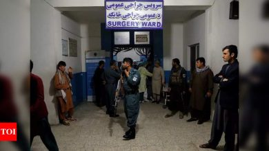 Afghan school blast toll rises to 58, families bury victims - Times of India