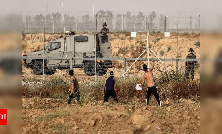 Israel vows to keep Jerusalem order, hundreds of Palestinians wounded - Times of India