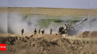 Air strikes, rockets drag Israel-Gaza conflict into sixth day - Times of India