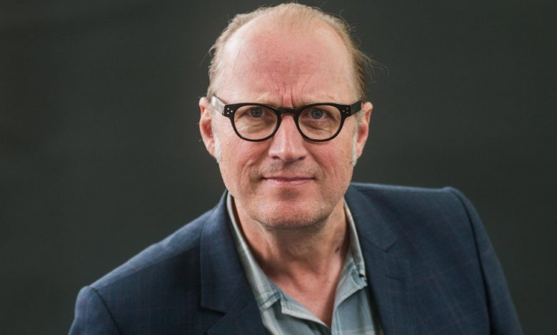 Comedian Adrian Edmondson rescued by fire crew after getting stuck on window ledge