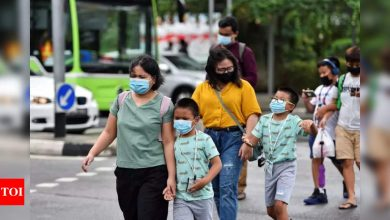 Covid-19: Singapore warns children susceptible to virus variants, shuts schools - Times of India