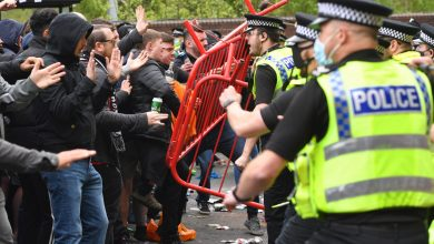 Manchester United game postponed after chaotic fan invasion, police clashes
