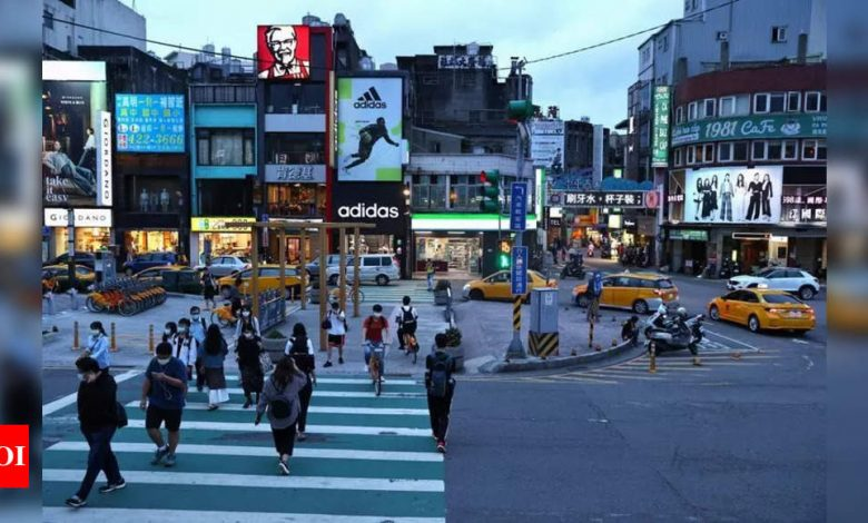 Taiwan tightens curbs after surge in domestic Covid-19 cases - Times of India