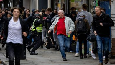 Hundreds of police seen 'storming' London's Leicester Square as fans clash during Scotland v England match