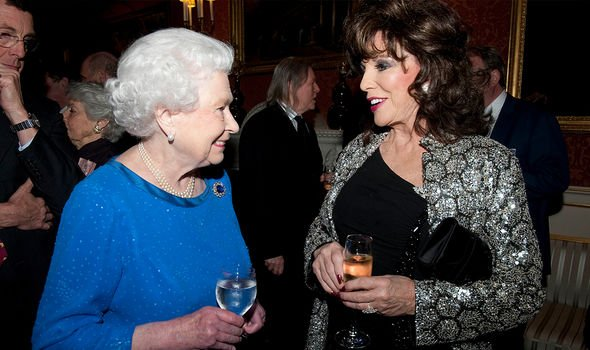 Joan Collins with the Queen