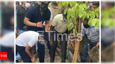 Ajay Devgn and son Yug spotted in the city planting trees, see pics - Times of India