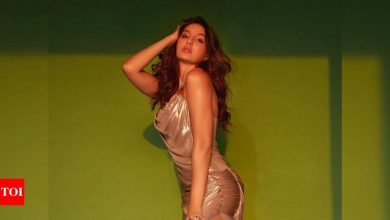 Watch: Nora Fatehi shows a unique way to wear a bikini and it is all things hilarious! - Times of India