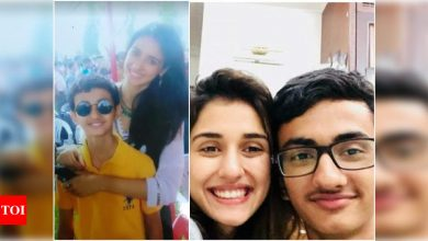 Disha Patani shares a series of throwback photos with her younger brother Suryansh for his birthday - Times of India