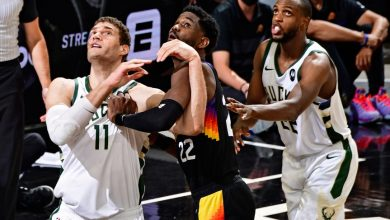 From left, Brook Lopez, Deandre Ayton and Khris Middleton position themselves for a rebound in Game 5 of the NBA Finals on July 17, 2021.