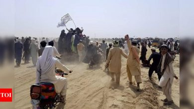 Pakistan guards use tear gas to disperse crowd at Afghan border - Times of India