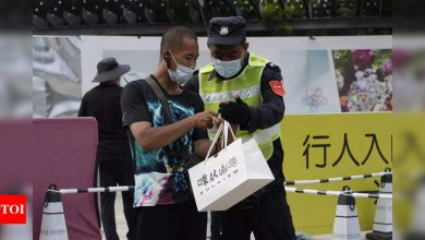 China reports 143 new coronavirus cases vs 125 the day before - Times of India