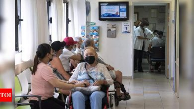Israel reimposes more restrictions as virus surges - Times of India