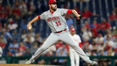 Heath Hembree pitches for the Reds.