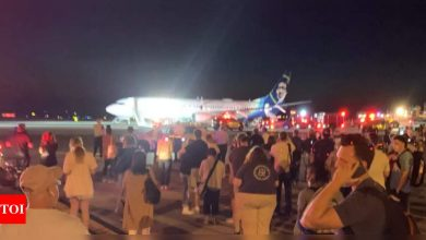 Plane evacuated after phone catches fire mid-air - Times of India