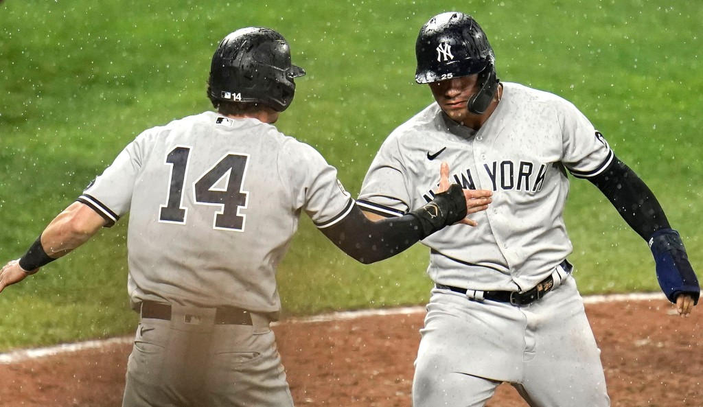 Gleyber Torres (right) and Tyler Wade celebrate after scoring on Brett Gardner's game-winning two-run single in the ninth inning of the Yankees' 4-3 win over the Orioles.